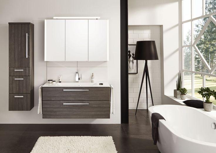 Dit badkamermeubel van Laguna heeft mooie strakke vormen, gecombineerd met een designwastafel van glas en gietmarmer.