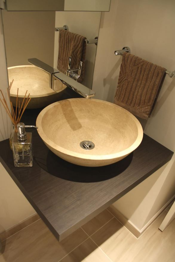 Main guest bathroom Travertine countertop basin