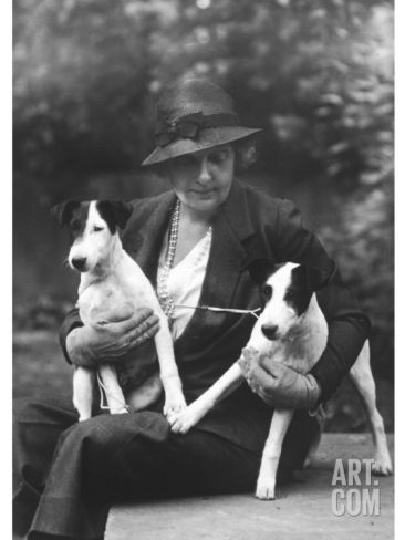 The Duchess of Newcastle Sits with Two of Her dogs