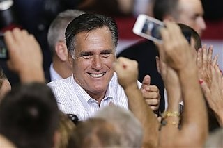 #63 9/22/12 Republican presidential candidate, former Massachusetts Gov. Mitt Romney greets supporters after speaking at a rally Friday, Sept. 21, 2012, in Las Vegas. Romney campaigned in Nevada as aides released a 2011 federal income tax return showing he and his wife, Ann, paid $1.94 million in federal taxes last year on income of $13.7 million. (AP Photo/Julie Jacobson) Close