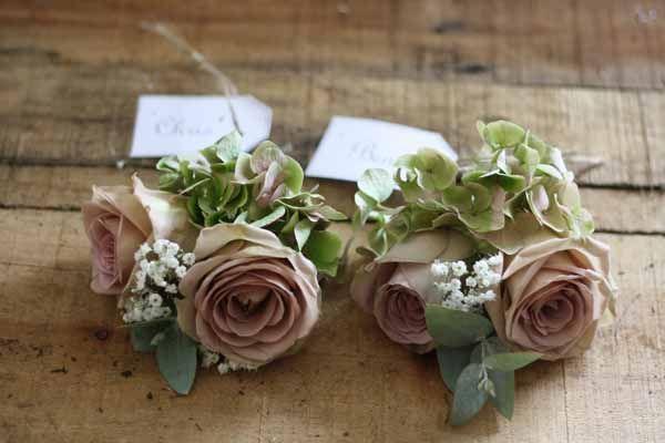 Buttonholes Amnesia Roses with Eucalyptus, Gypsophila & Hydrangeas.
