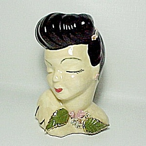 Ceramic Lady Head Vase Pink Roses Vintage 1950s. I have a few of these in different colors.
