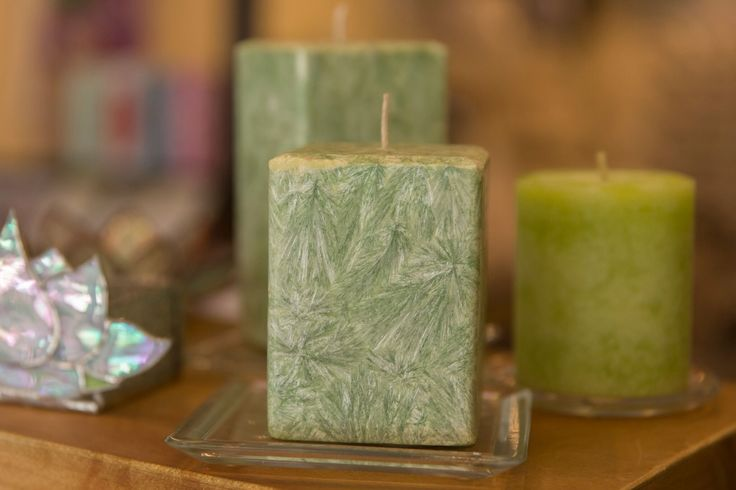 Pretty green palm wax pillar Candles.   Available in store at Chandelle Galerie.  #Candles