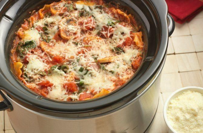 A vegetarian lasagna recipe made with a mushroom-spinach tomato sauce layered with uncooked lasagna noodles and cheese in a slow cooker. Recipe courtesy of Hunt's.