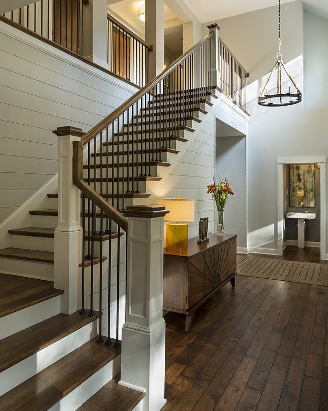 "#Building or #Renovating? These details are for you! #Foyer Design: Soft gray wall paint color is #BenjaminMoore Moonshine. #Shiplap walls are 7"" poplar shiplap, nickel spacing - Scherer Bros Lumber. #HardwoodFlooring is 5"" #Hickory #Floor with #Walnut stain (this is incredible, isn't it?!). #Balusters:  These are 1"" 3/4 balusters, poplar risers, painted in #BenjaminMooreWhiteCloud. Hickory rail and treads stained to match floor. Design by @charlieandcodesign and built by @hadstrombuilder…"