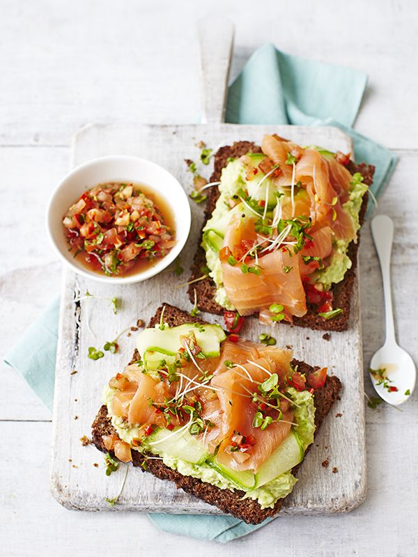 Avocado on toast with smoked salmon - Avocado on toast with smoked salmon and a tomato dressing – a recipe that's bound to get you out of bed in the morning. Creamy avocado and delicious smoked salmon feel like an indulgence, but this dish comes in at under 300 calories meaning you can have a little bit of luxury any day of the week.