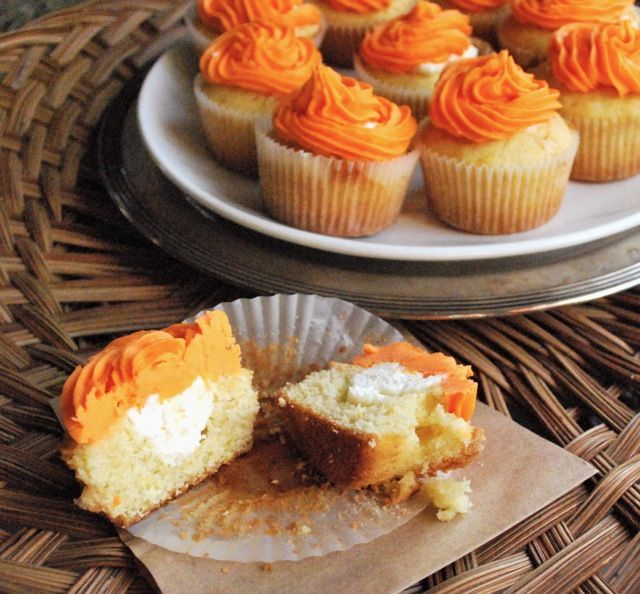 Orange dreamsicle cupcakes, like a grown up version (and likely way tastier) than Orange Hostess cupcakes (my favorite when I was a kid)