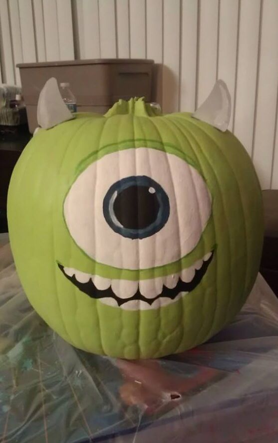 Monsters Inc. Mike Wazowski pumpkin, used acrylic paint and cut the horns out of an empty cereal box, painted them and hot glued them on.