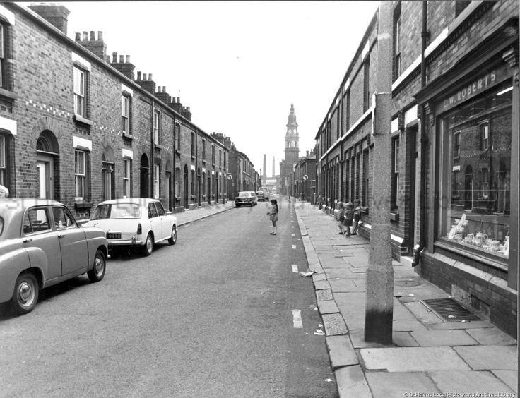 *TRAY - Memories are made of this - kids on the street* MCL/3/101 Black and white photograph showing Hamer Street, St.Helens 1963. ....... C.W. Roberts' shop can be seen on right hand side. Beecham's Clock can be seen in the distance. ... MCL - Clare Collection 3 - Black and white photographs and drawings of St.Helens