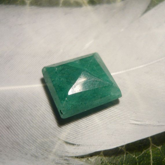Beautiful Emerald, faceted with an irregular Step Cut. This Gem is opaque and has minor natural inclusions. The last two photos show the back side of
