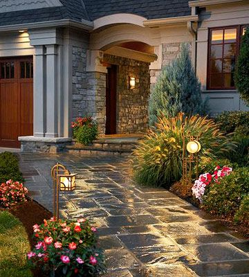 gorgeous entry landscaping and stone walkway