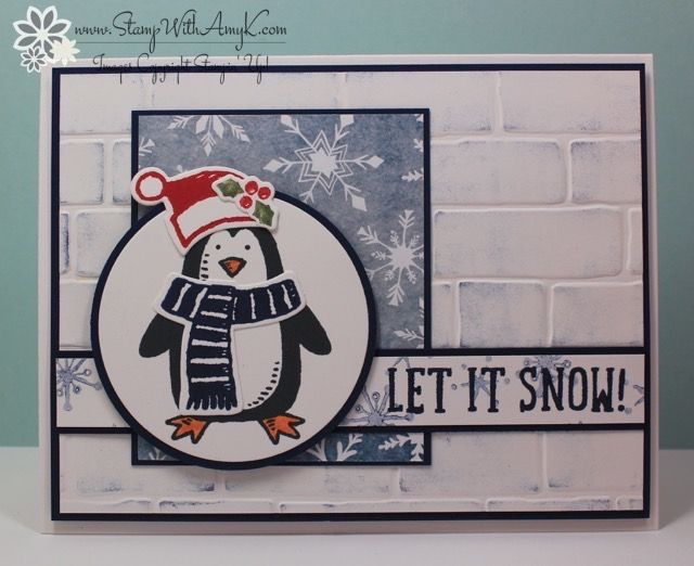 Stamp: Snow Place Ink: Night of Navy, Pumpkin Pie, Real Red, Mossy Meadow Tools: Brick Wall Embossing Folder, 2-1/2″ Circle Punch, Snow Friends Framelits Dies Thick Whisper White – 5-1/2″ x 8-1/2″ card base Night of Navy – 4″ x 5-/4″ panel, 2-3/8″ x 3-1/8″ panel, 3/4″ x 5-1/8″ panel, 2-1/2″ Circle Punch Whisper White – 3-7/8″ x 5-1/8″ panel, 5/8″ x 5-1/8″ strip, three Snow Friends Framelits die cuts, 4″ x 5″ panel (inside card) Season of Cheer Designer Series Paper – 2-1/2″ x 3″ panel