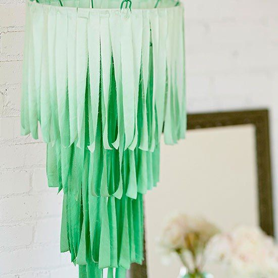 Make a mod chandelier with a little spray paint and rows of cascading fabric strips.