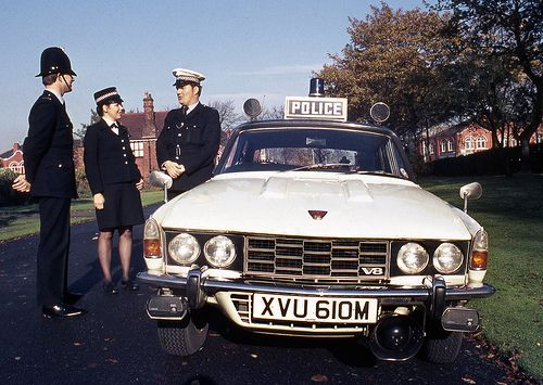 A traffic officer stands beside his Rover P6 V8 vehicle as he chats to colleagues out on foot patrol. The slide carries no information about exactly where or when the image was taken. Do you recognise the location? The Rover P6 was produced from 1963 to 1977 & was used as a traffic patrol vehicle by UK police forces. This image dates from the mid 1970s and comes from a series of training slides in the collection of the Greater Manchester Police Museum & Archives. http://www.gmpmuseum.com