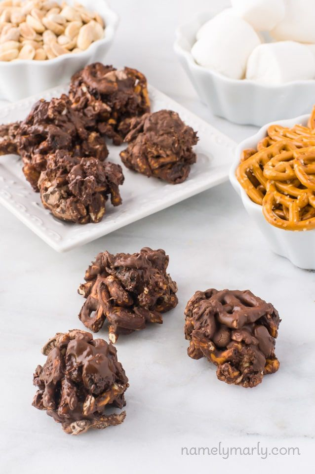 Dive into a bowl of these Chocolate-Covered Trail Mix Clusters today - made with pretzels, vegetarian marshmallows, dried cherries, and peanuts!