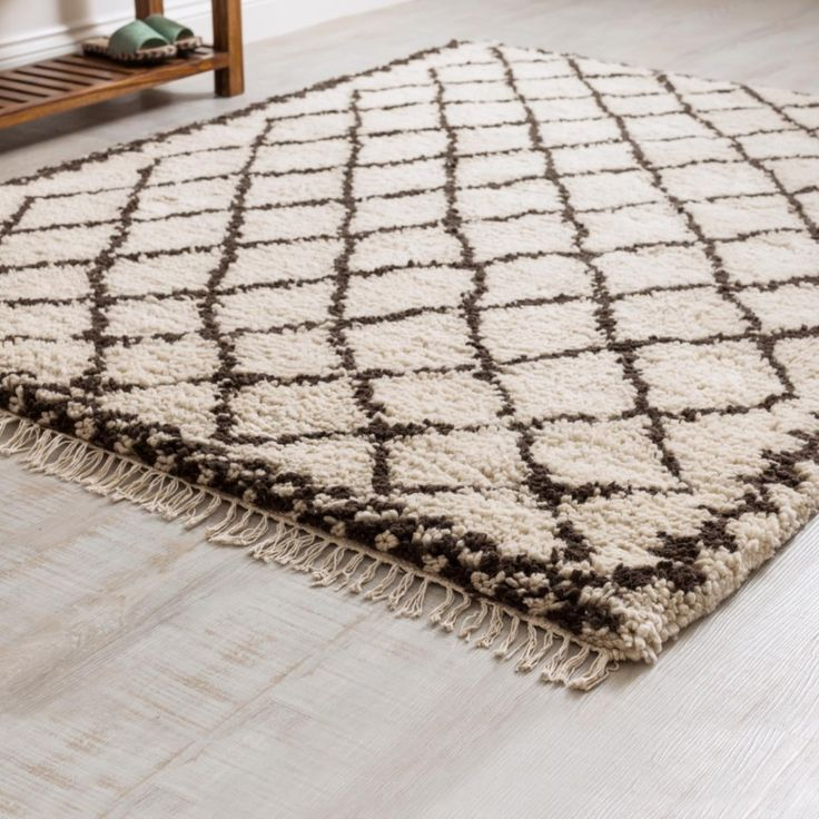 Marrakech Diamond Berber Rug is hand tufted in cream with traditional black diamond pattern. Made in India and fairly traded, the lovely shaggy rug has fringe trims.