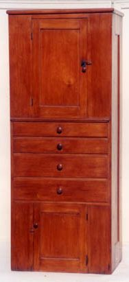 "Cupboard over drawers over cupboard, pine, traces of original red, varnish finish, inset paneled door, cast iron escutcheon, original key, three-shelf interior, over four graduated drawers, over single door cupboard, New Lebanon, NY, c. 1830-40, 7' h, 33 1/2"" w, 9 1/4"" d."