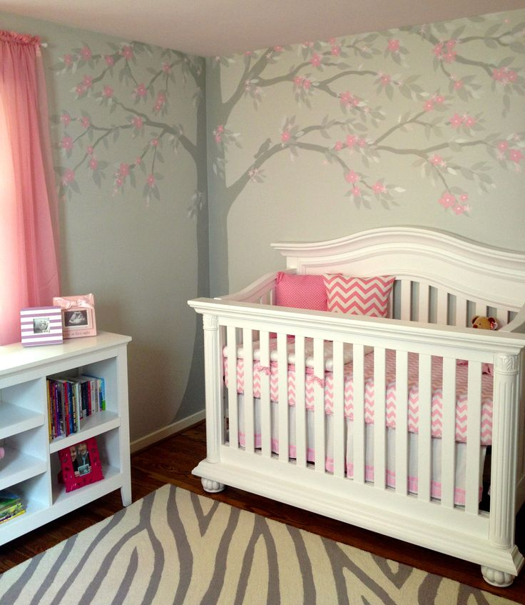 Soft pink and gray painted walls, ceiling, and floral tree mural in Baby G's nursery. Chevron and zebra accents.