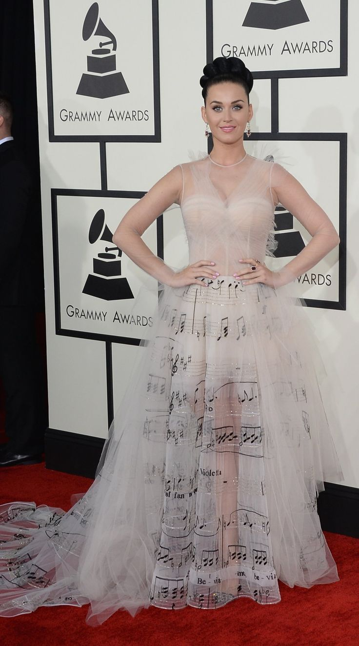 """Katy Perry's Verdi dress at the Grammy Awards 2014 featured the score from Verdi's La Traviata. """"The dress, designed by Valentino, took more than 1,600 hours to embroider with Verdi's score. It's titled La Valse de Violetta Valéry, named after the piece featured on the gown: Violetta's waltz, Sempre libera degg'io."""""""