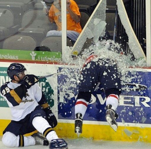 Image result for hockey player going through glass