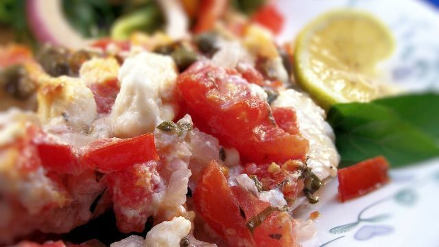 This is my absolute favorite fish recipe for its wonderful flavor and ease of preparation. I love Mediterranean food and the mild, tender Roughy is a fantastic compliment to the fresh and vibrant feta, caper and tomato topping. This is a great, healthy recipe that will have you feeling like you just ate in a fancy restaurant. I adapted this recipe from a recipe found at epicurious.com. As usual, substituting or eliminating any ingredients will greatly change the flavor as each ingredient…