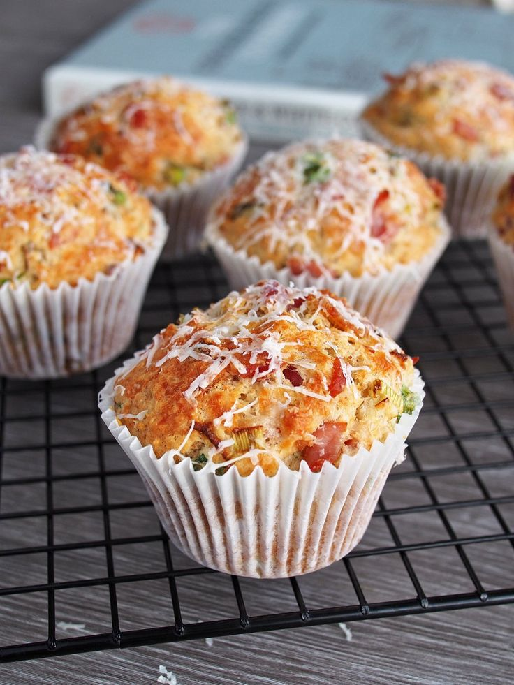 Savory Muffins made with extra virgin olive oil and filled with bacon bits, Parmesan and spring onions