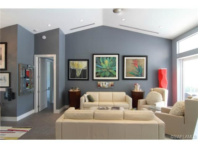 Grey Gray Contemporary Living Room With Cream Leather Furniture And Colorful Artwork Park Shore In