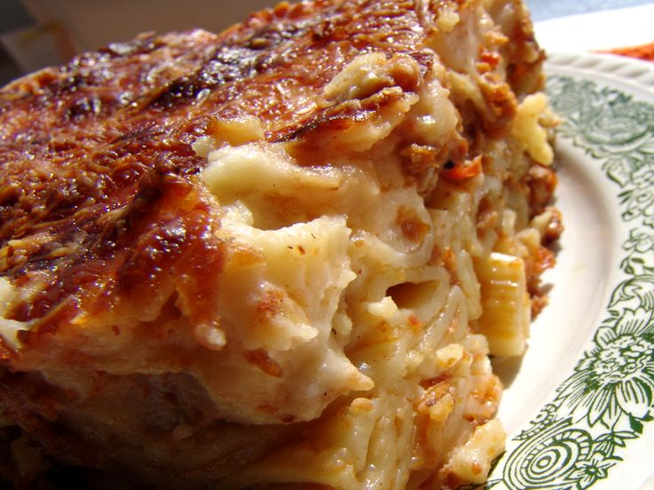 This is another version of the traditional pastitsio and I prefer it because you don't have to be very careful with weights and measures. You just mix everything together, except the béchamel sauce, and you have a scrumptious meal. It can also bec
