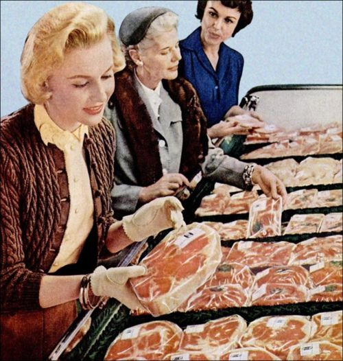 Meat sale. Hey...dibs on the big piece of meat.  the chick in blue is not happy about this...:
