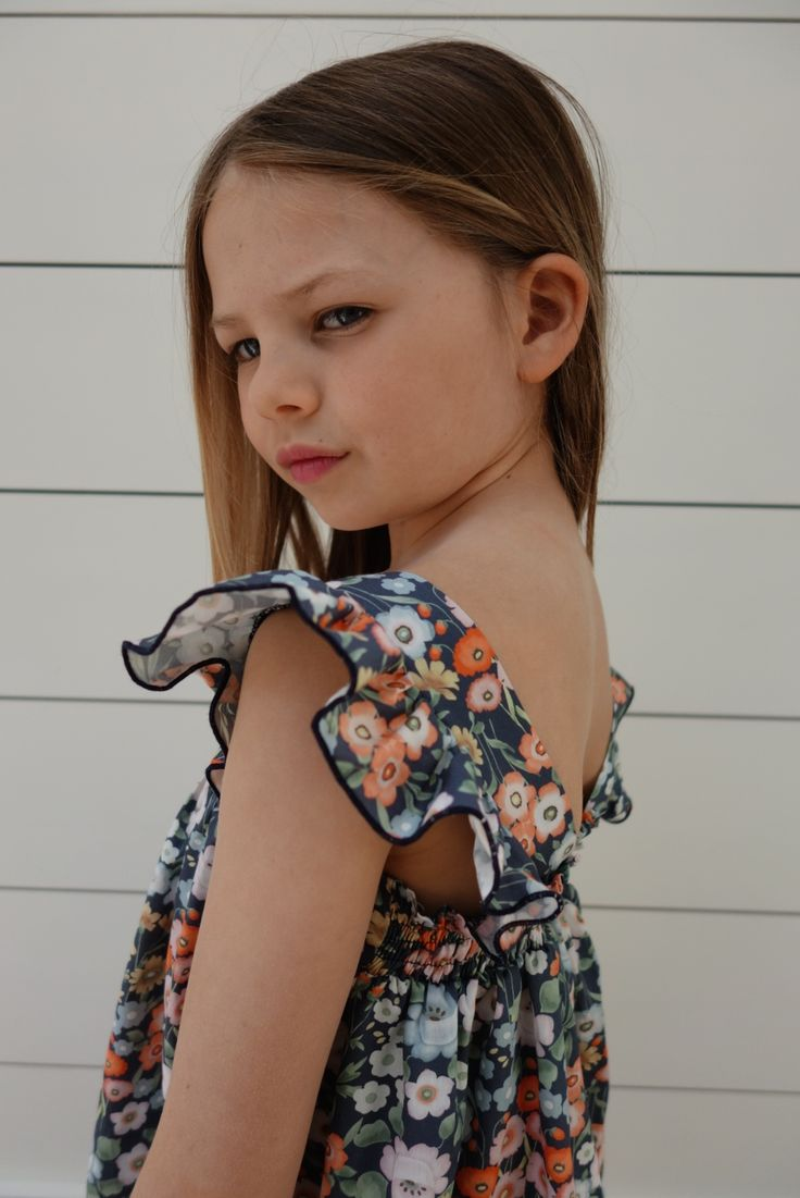 Blue Poppy Dress with gorgeous frill detail. Ages 3-10 Years