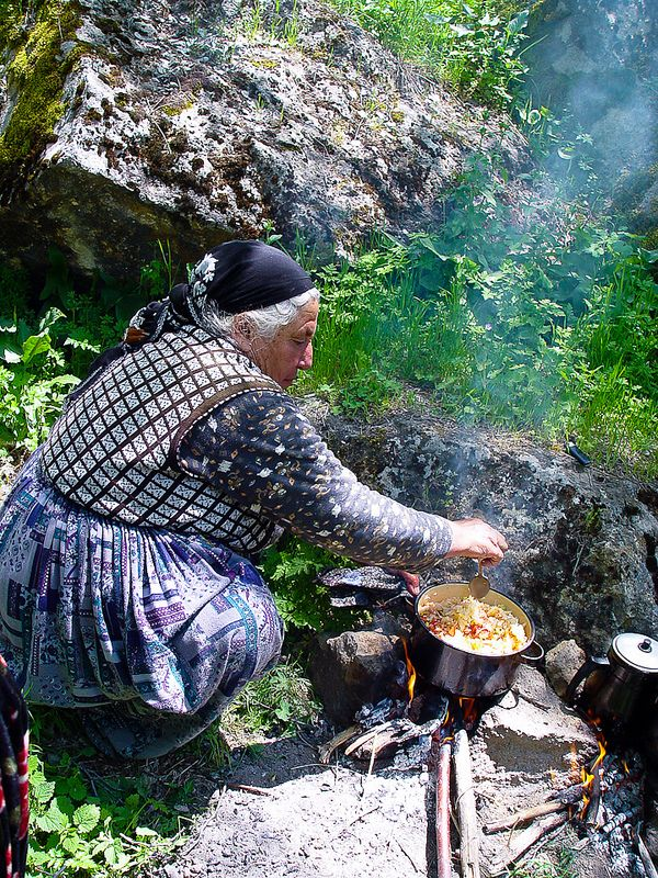 Ilhara Gorge, Turkey.  Lunch break at the communal garden in the gorge.  A vegetable stew cooking over the fire for the three generations of women working in the garden together.