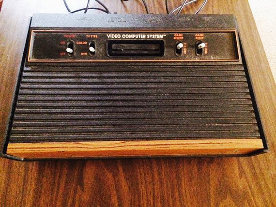 Atari 2600 A Woody Game Console With Loads Of by CoolThenCoolerNow