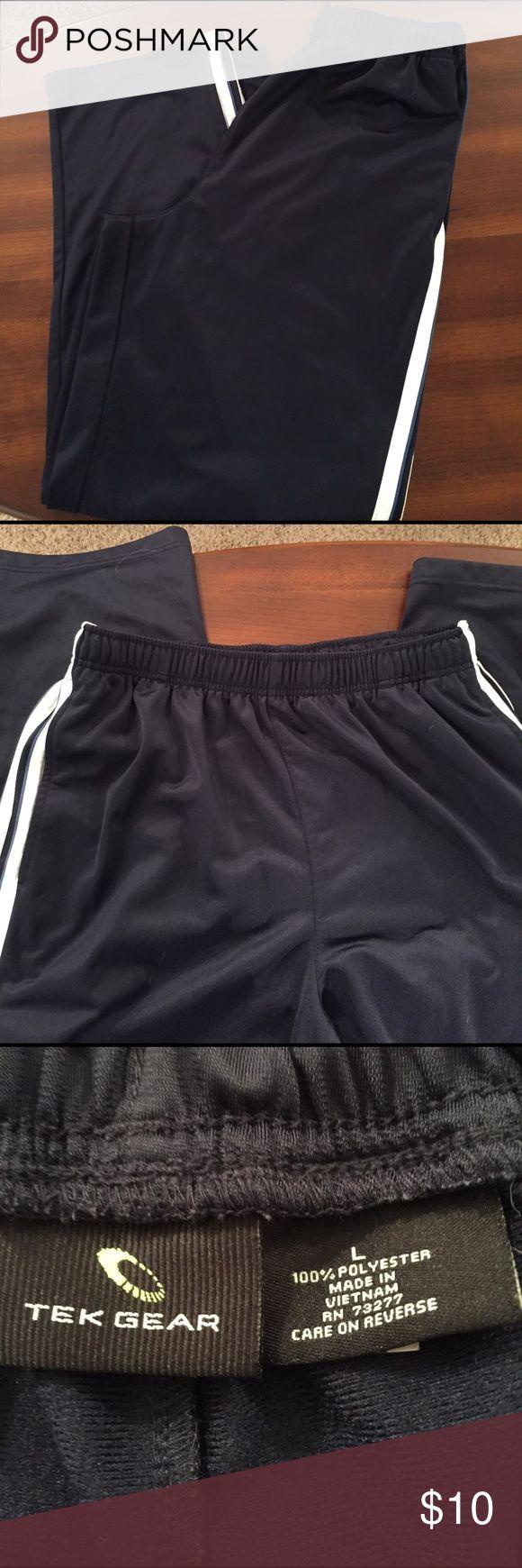 Men's workout pants Men's athletic workout pants.  Worn once, navy blue with white stripes down each side.  Elastic waist. Tekgear Pants Sweatpants & Joggers