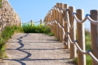 Pathway with wood post and thick rope fence. | Yard and ...