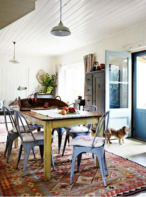 beadboard ceiling, beautiful table, funky old chairs, barn lighting, and amazing rug.  When can I move in?