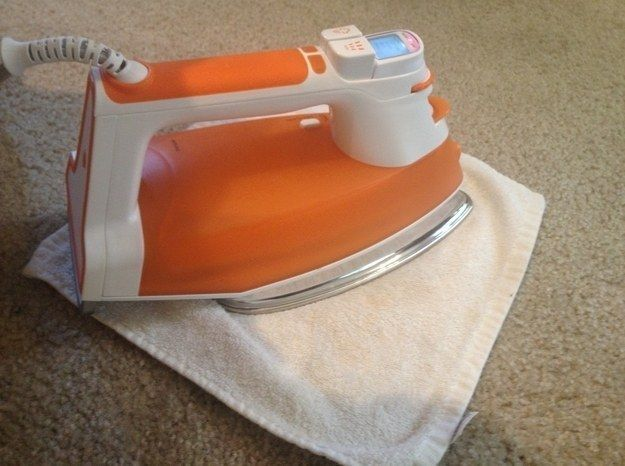 Use an iron and vinegar to get rid of deep set carpet stains.