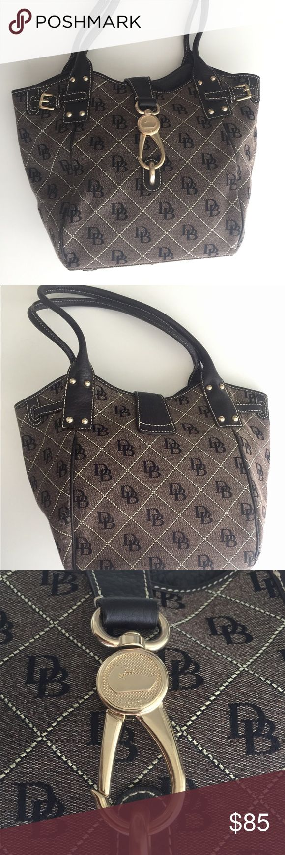 Dooney & Bourke tote bag purse dark brown black Brand new. Never used. Very sturdy high quality material. Dooney & Bourke purse with gold clasp. Can fit over the shoulder. Leather straps. Limited edition. Color: brown & dark brown exterior, light pink interior. Has one zipper pocket and one phone pouch inside. Dooney & Bourke Bags Totes