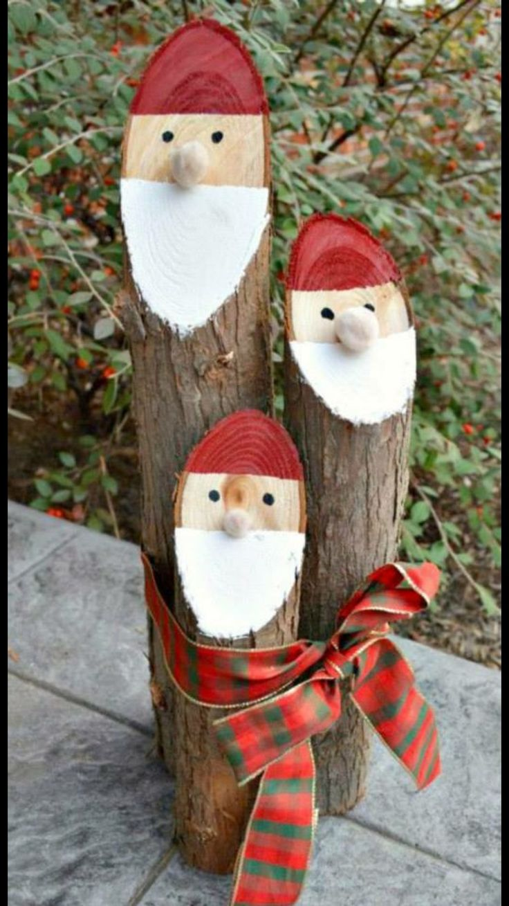 Santas from angled logs.