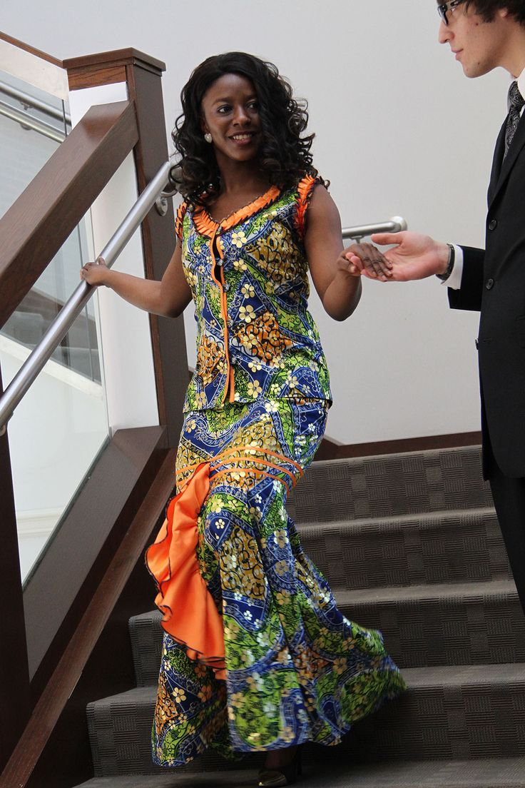 Francess Gbondo descending the stairs at an ISO fashion show.