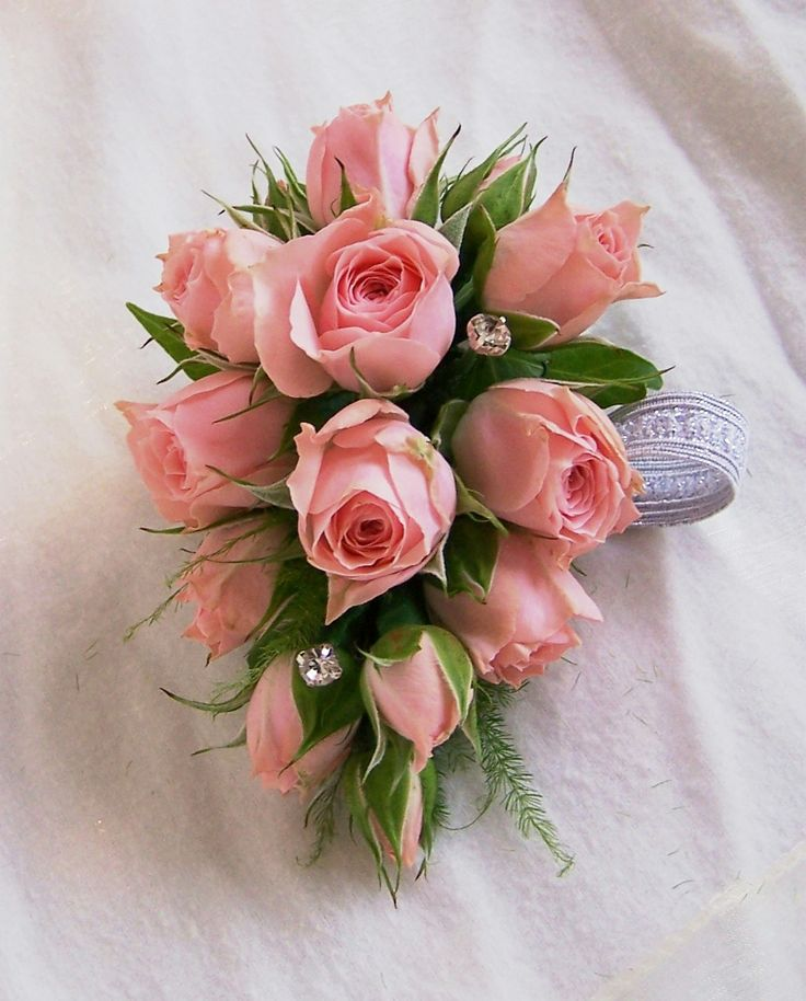 Another example of a miniture rose wristlet. Wrist corsage. Softer pinks and apricots for Piri's bridesmaids.