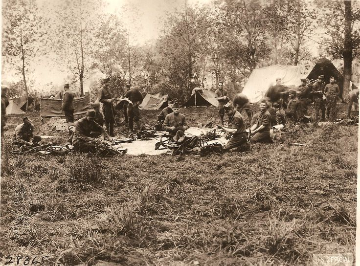 A few members of Battery E, 102nd F.A. cleaning harnesses. Thierville sur Meuse, France. October 22, 1918 My grandfather's outfit.