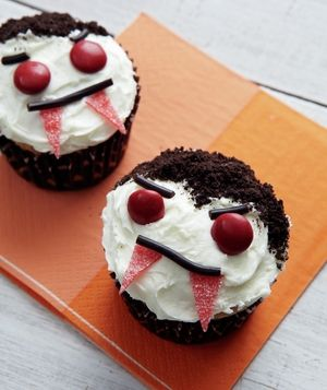 Sink your teeth into one of these menacing treats made from shoestring licorice, red candies, and sour candy tape. Get the recipe for Vampire Cupcakes.