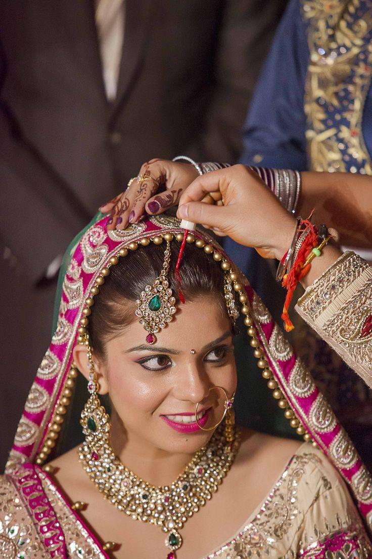 'Maang ka Sindoor'. Symbolizes a married woman.