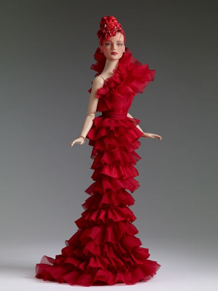"""$224.99 Tyler Wentworth, All Drama Sydney, Tonner Doll Company Dressed Doll  Face includes hand-painted details  Fine quality vinyl and hard plastic  Sydney head sculpt  16"""" Tyler bending wrist body  Tyler skin tone  Blue painted eyes  Mink rooted saran hair  Red one shoulder strap ruffle dress  Red fascinator with faux flowers, rhinestones, and veil  Red rhinestone #Pin2Win stud earrings  Red rhinestone bracelet  Nude pantyhose  Red satin pumps  Stand  LE 500"""