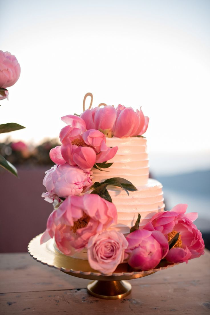 What a gorgeous Peony decoration for this wedding cake | Pink coral charm peony topped wedding cake: Floral Design: Betty Flowers Santorini - http://www.bettyflowerssantorini.gr Photography: Sodapop Photos  - http://www.sodapopphotos.smugmug.com   Read More on SMP: http://www.stylemepretty.com/destination-weddings/2017/03/23/spring-santorini-wedding/
