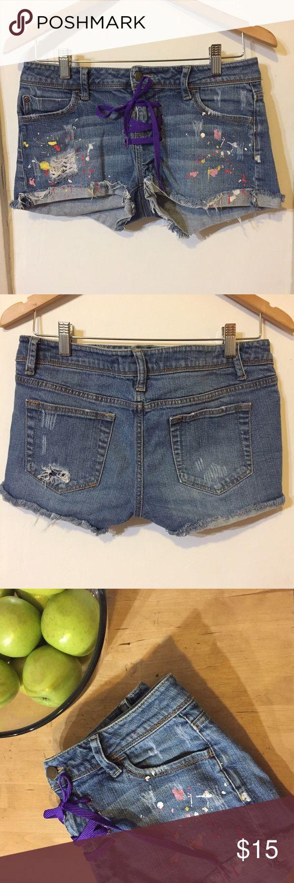 2.1 Denim distressed paint splatter jean shorts 2.1 Denim distressed paint splatter jean shorts with shoelace tie front, EUC. 10 inches in length. 2.1 Denim Shorts Jean Shorts