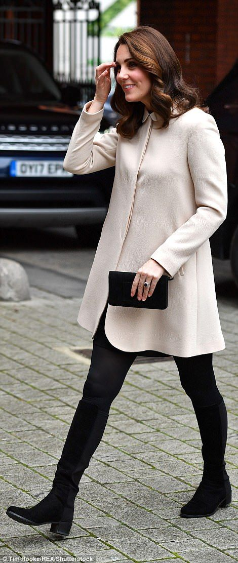 She kept her look simple, accessorising with a small black clutch bag...