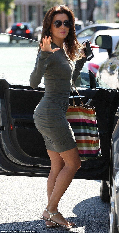 Booty-ful: Eva Longoria gave spectators an eyeful in a figure-flattering dress as she left...