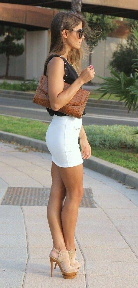 Teen sexy legs in mini skirt