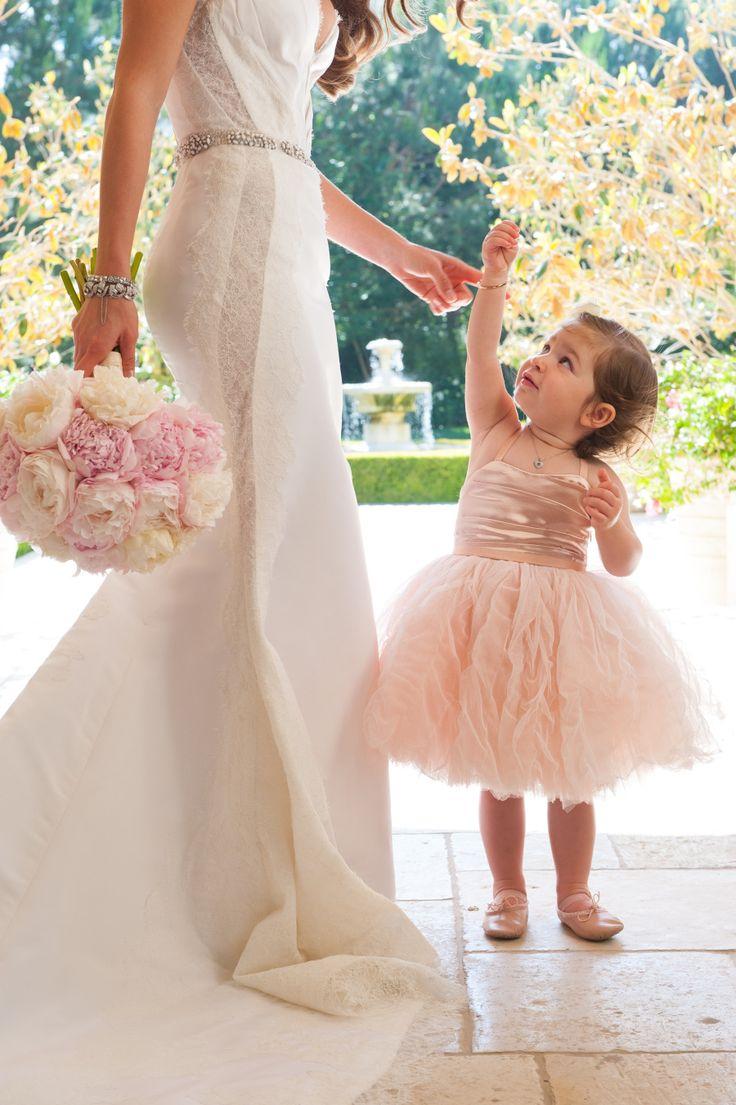 Cute, cute flower girl -- on #smp. See the full wedding here: http://www.StyleMePretty.com/2014/04/28/glamorous-garden-affair-in-beverly-hills/